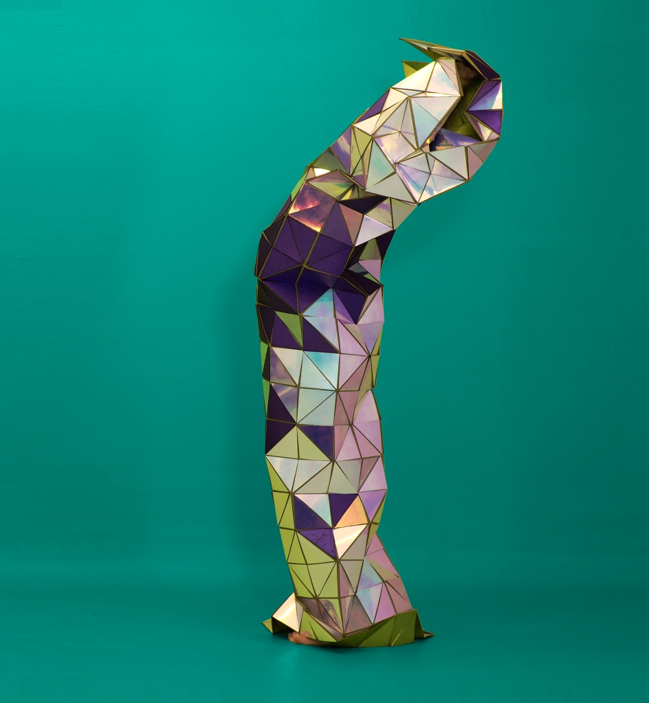 silver and purple metallic crumpling column with folds, on teal background